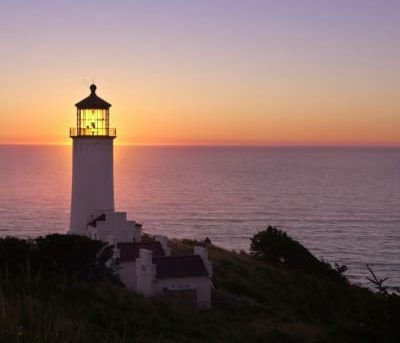lighthouse at sunset/sunrise
