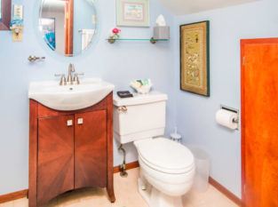 Pacifica Suite bathroom with wood vanity
