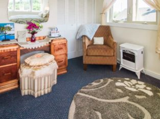 Stargazer Suite with antique dresser and chair for relaxing