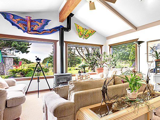 room with large picture windows, sofas and chairs