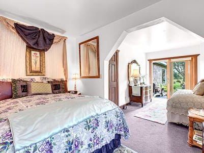 Garden Suite bedroom with 2 beds, one with purple and white bedspread
