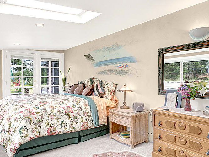 Dunes Suite bedroom with skylight and murial on wall
