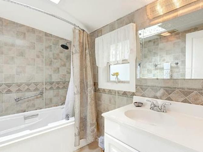 Bathroom of Dunes Suite with brown accents