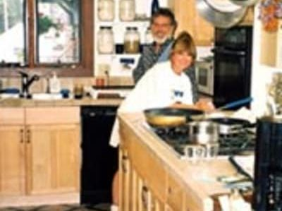 two people in kitchen