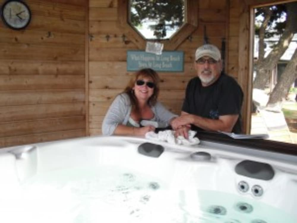man and lady leaning on hot tub